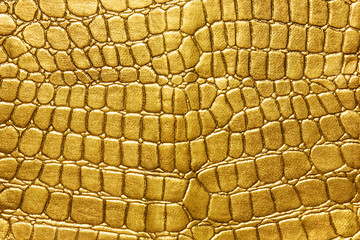 Poster Crocodile Gold background. background of gold lizard armor pattern. Crocodile yellow or golden skin. For luxury items
