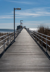 Boardwalk Fishing Pier Extending out over Ocean