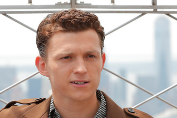 Actor Tom Holland poses for a photograph on top of the Empire State Building to promote the film, Spider-Man: Far From Home in New York