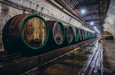 Old wooden barrels in cellars of Pilsner Urquell Brewery, Czech Republic