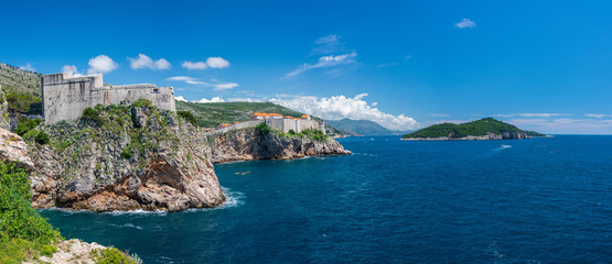 Panorama of the cliffside under Fort Lawrence and city walls of the old town in Dubrovnik