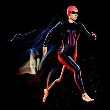 one caucasian woman triathlon triathlete studio shot isolated on black background with light painting effect