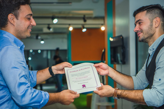 business executive management having congratulation to executive staff who get award with certificate