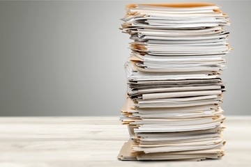 Stack of papers isolated on white background