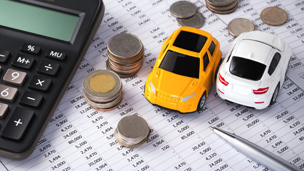Cars with coins and calculator, buying, leasing, car loan, car finance