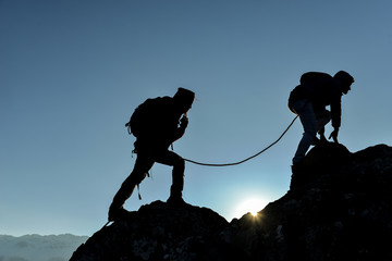 concept of professional two climbers crossing the cliffs