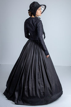 Victorian woman in black outfit