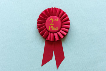 Red 2nd Place Winners rosette on light blue