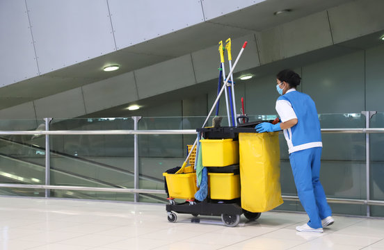 Closeup of woman cleaning worker doing her work with janitorial,  cleaning equipment and tools for floor cleaning.