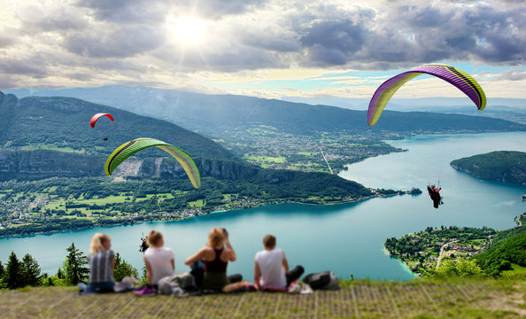 Paragliders with parapente jumping of Col de Forclaz near Annecy in French Alps, in France.