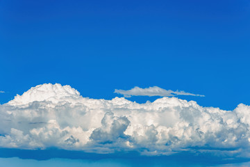 large white cumulus cloud with beautiful texture in the blue sky