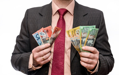 Man holding australian dollar banknotes close up