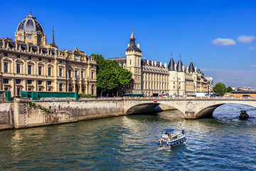 Conciergerie Castle and Seine River with cruise tour boat. Paris, France Wall mural