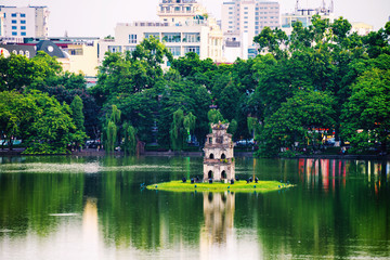 Turtle Tower at Hoan Kiem Lake in Hanoi, Vietnam. Tree at the foreground Wall mural