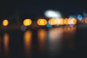 Retro toned blurred street lights, urban abstract background