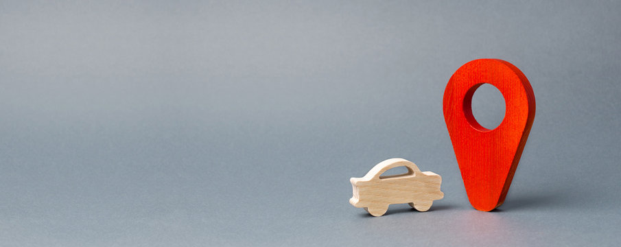 Wooden car figure drive near a red pin location marker. Travelling by car. Search for the best route and navigation systems. Local Attractions. Car Breakdown and call for help. Banner, copy space
