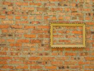 Picture frame from baguette on the background of an old brick wall