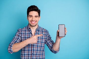 Fototapeta Photo portrait of confident positive optimistic cheerful with beaming toothy smile agent salesman trader freelancer businessman holding cellular in hand arm isolated pastel background obraz