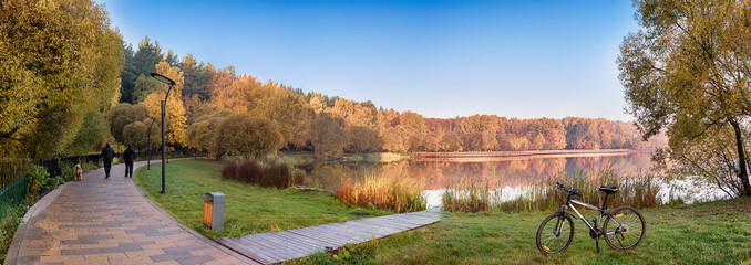 Moscow. October 15, 2018. Autumn landscape in the Meshchersky Park. People are walking their dogs along the picturesque paths around the pond early in the morning