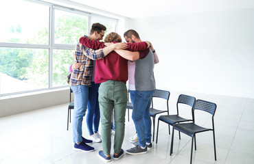 Fotomurales - Young people hugging together at group therapy session