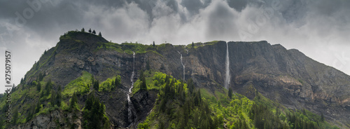 Wall mural panorama mountain landscape with lush green forest and several waterfalls