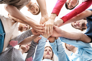 Fotomurales - People putting hands together at group therapy session, bottom view