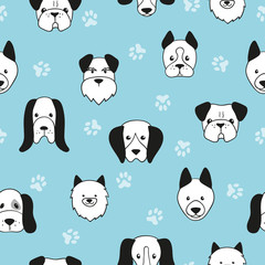 Seamless cute dogs pattern. Vector blue background with dogs heads.