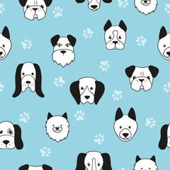 Modèle sans couture de chiens mignons. Fond bleu de vecteur avec des têtes de chiens.