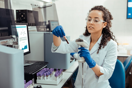Serious smart female researcher studying human DNA