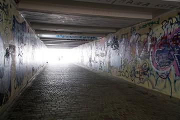 Pedestrian crossing tunnel, Dark and long underground passage with light