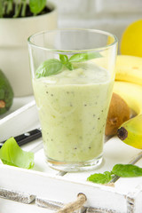 Green smoothie with banana, kiwi, Basil and avocado. Delicious healthy drink, summer snack, fresh taste