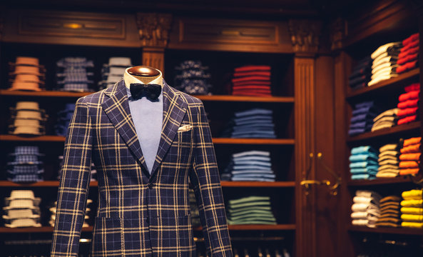 Men clothing store, suit with shirt and bow tie on mannequin