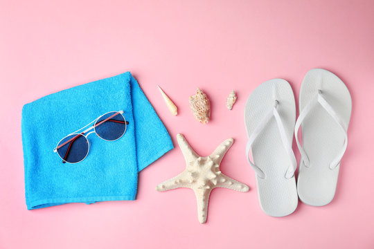 Flat lay composition with different beach objects on color background