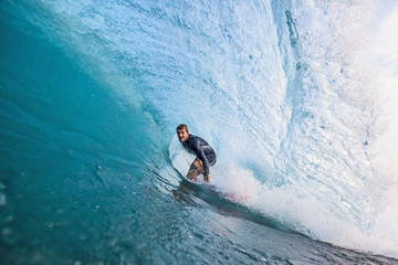 Surfer stands in a Tube
