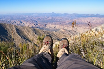 A mountaineer enjoying the view from Saptoukop peak in the Kouga mountains, South Africa. Hiking background picture.
