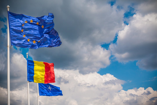 European Union, Romania And NATO Flags Fluttering In The Wind