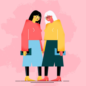 Two young women dressed in modern clothes are standing together. Meeting of female friends or colleagues. Female geometric characters isolated on pink background.