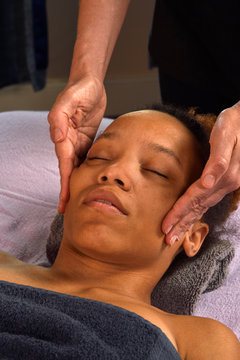 Massaging Face at Day Spa
