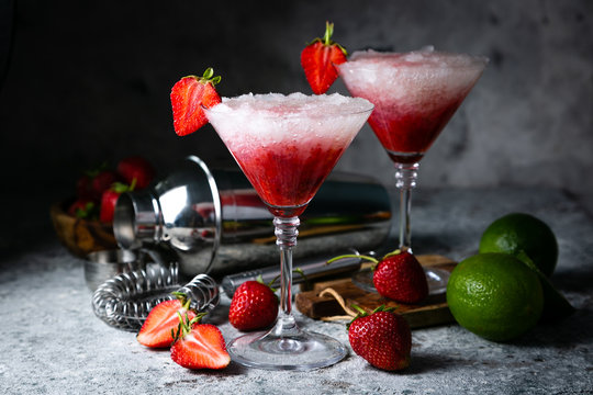 Strawberry margarita cocktail and ingredients, copy space