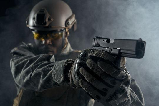 Gun in hands of American solider.