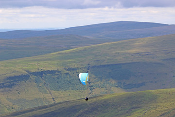Wall Mural - Paraglider in the Brecon Beacons, Wales