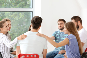 Fotomurales - Young people calming man at group therapy session