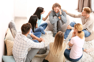 Fotomurales - People calming man at group therapy session