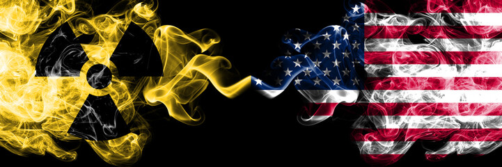 United States of America, American vs nuclear smoky mystic flags placed side by side. Thick colored silky smokes combination of United States of America, American flag and radioactive sign.