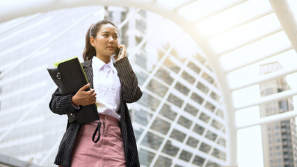 Wall Mural - Young asian business woman talking phone contact with partner at outdoor, business people success in job, business co-working teamwork concept
