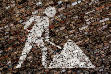 Construction worker symbol on brick wall