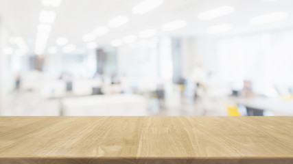Empty wood table top and blur glass window wall in office building space interior background - can used for display or montage your products.