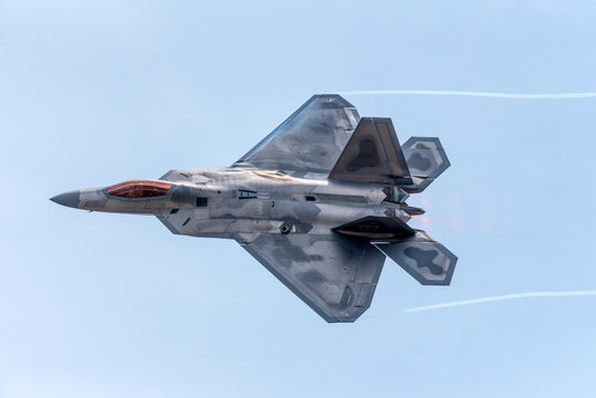 Advanced Tactical Fighter Jet Against Blue Skies