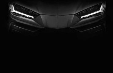 Wall Mural - Silhouette of black sports car with LED headlights on black background,copy space