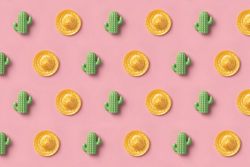 Sombrero and cactus pattern on pink background. Creative mexican